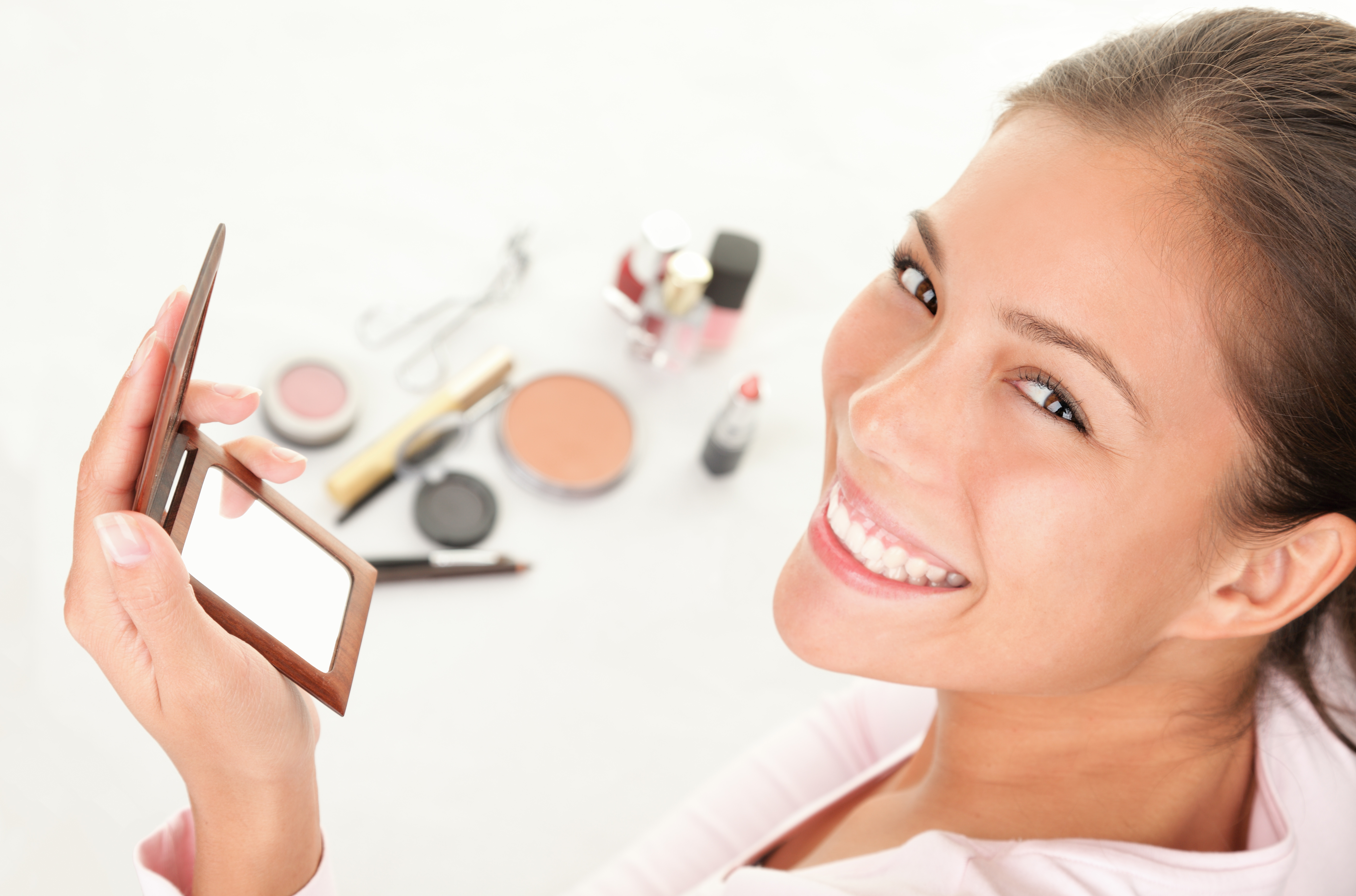 young women posing with makeup in the background